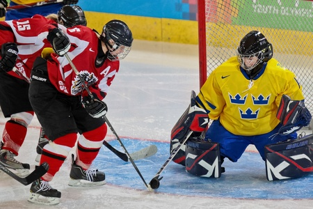 INNSBRUCK, AUSTRIA - JANUARY 17 Anna Meixner (Austria) tries to score a goal as Sweden beats Austria 3:0 in the ladies ice hockey tournament on January 17, 2012 in Innsbruck, Austria.