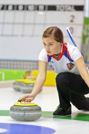 INNSBRUCK, AUSTRIA - JANUARY 17 Alzbeta Baudysova (Czech Republic) and her team lose 8:4 against Switzerland in the curling tournament on January 17, 2012 in Innsbruck, Austria. Editorial