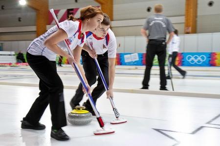 innbruck: INNSBRUCK, AUSTRIA - JANUARY 17 Marek Cernovsky and Alzbeta Baudysova (Czech Republic) and their team lose 8:4 against Switzerlandin the curling tournament on January 17, 2012 in Innsbruck, Austria.