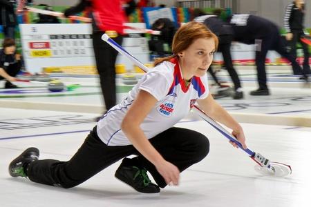 yog: INNSBRUCK, AUSTRIA - JANUARY 17 Alzbeta Baudysova (Czech Republic) and her team lose 8:4 against Switzerland in the curling tournament on January 17, 2012 in Innsbruck, Austria. Editorial