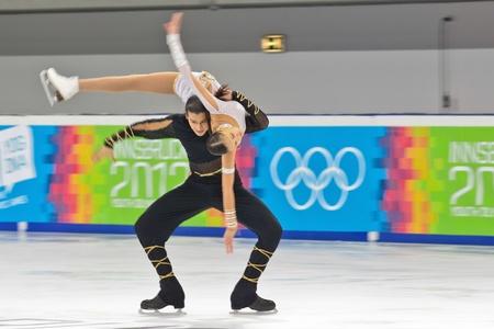innbruck: INNSBRUCK, AUSTRIA - JANUARY 17 Karina Uyurova and Ilias Ali (Kazachstan) place 6th in the pairs ice dance event on January 17, 2012 in Innsbruck, Austria.