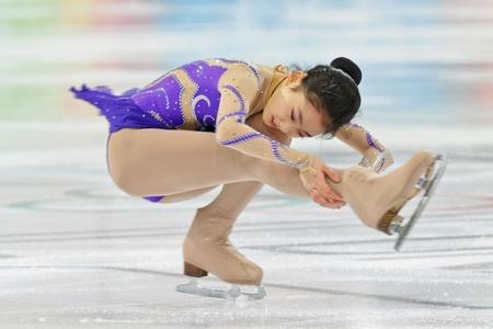 INNSBRUCK, AUSTRIA - JANUARY 17 Zijun Li (China) places third in the ladies' figure skating event on January 17, 2012 in Innsbruck, Austria. Stock Photo - 12160105