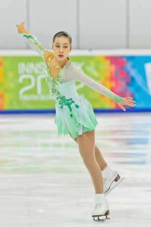 INNSBRUCK, AUSTRIA - JANUARY 17 Risa Shoji (Japan) places 6th in the ladies' figure skating event on January 17, 2012 in Innsbruck, Austria. Stock Photo - 12160109