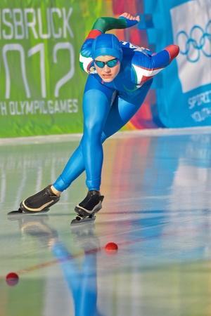 innbruck: INNSBRUCK, AUSTRIA - JANUARY 18 Gloria Malfatti (Itay) places 10th in the ladies 3000m speed skating event on January 18, 2012 in Innsbruck, Austria.