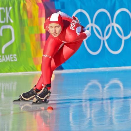 innbruck: INNSBRUCK, AUSTRIA - JANUARY 18 Aleksander Milena Kapruziak (Poland) places 6th in the ladies 3000m speed skating event on January 18, 2012 in Innsbruck, Austria. Editorial