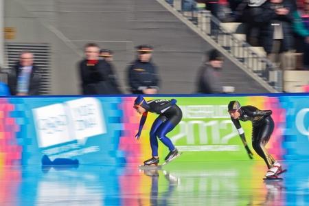innbruck: INNSBRUCK, AUSTRIA - JANUARY 18 Rio Harada (Japan, right) places second in the ladies 3000m speed skating event, Su Ji Jang (Korea, left) places third in the ladies 3000m speed skating event on January 18, 2012 in Innsbruck, Austria.