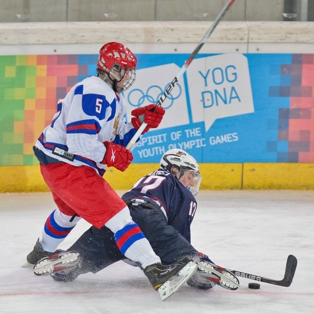 INNSBRUCK, AUSTRIA - JANUARY 18 Egor Orlov (Russia) and Jack Eichel (USA) fight for the puck as Russia beats the USA 7:1 in the mens ice hockey tournament on January 18, 2012 in Innsbruck, Austria.
