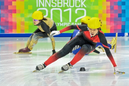 INNSBRUCK, AUSTRIA - JANUARY 18 Aili Xu (China, #3) places second in the ladies 1000m  short track A final on January 18, 2012 in Innsbruck, Austria.