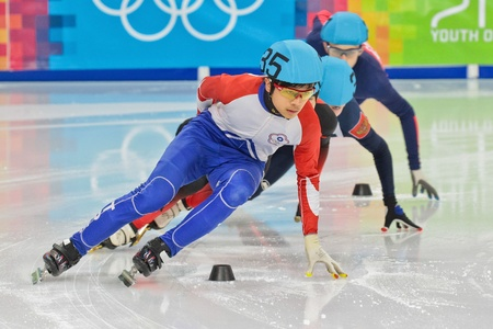 INNSBRUCK, AUSTRIA - JANUARY 18 Yin-Cheng Chang (Taiwan, #35) places third in the mens 1000m  short track C final on January 18, 2012 in Innsbruck, Austria.