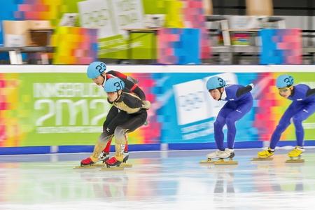 innbruck: INNSBRUCK, AUSTRIA - JANUARY 18 Kei Saito (Japan, #30) places 4th in the mens 1000m  short track A final on January 18, 2012 in Innsbruck, Austria.