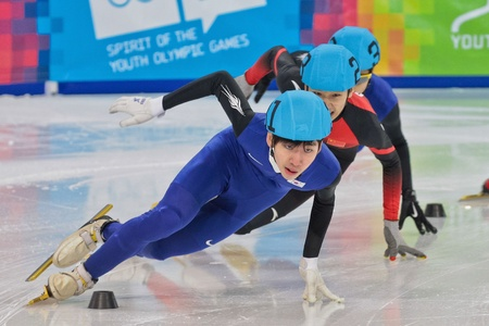 yog: INNSBRUCK, AUSTRIA - JANUARY 18 Hyo Jun Lim (Korea, #31) wins the mens 1000m  short track A final on January 18, 2012 in Innsbruck, Austria. Editorial