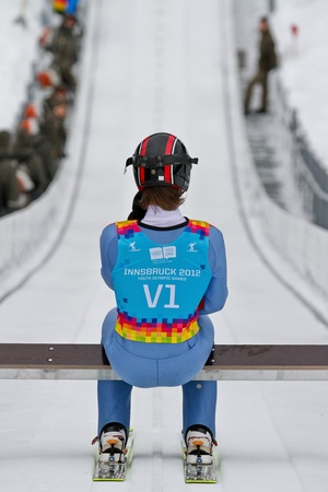 SEEFELD, AUSTRIA - JANUARY 19 Test jumper V1 prepares to go down the ski jump in Seefeld during a training session on January 19, 2012 in Seefeld, Austria.