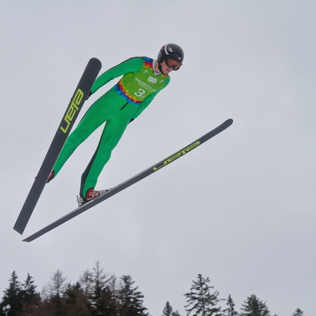 innbruck: SEEFELD, AUSTRIA - JANUARY 19 Michal Pytel (Poland) jumps in Seefeld during a training session on January 19, 2012 in Seefeld, Austria.