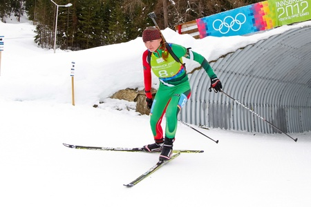 SEEFELD, AUSTRIA - JANUARY 19 Liudmilla Kiaura of team Belarus places 10th in the mixed biathlon relay event on January 19, 2012 in Seefeld, Austria.