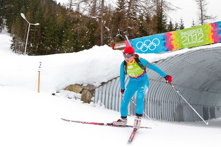 SEEFELD, AUSTRIA - JANUARY 19 Anastasiya Merkushyna of team Ukraine places 4th in the mixed biathlon relay event on January 19, 2012 in Seefeld, Austria. Stock Photo - 12160197