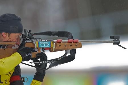 SEEFELD, AUSTRIA - JANUARY 19 Maximilian Janke of team Germany wins the mixed biathlon relay event on January 19, 2012 in Seefeld, Austria. Stock Photo - 12160189