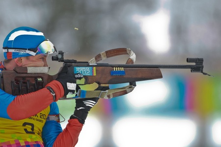 SEEFELD, AUSTRIA - JANUARY 19  Aleksei Kuznetcov of team Russia is disqualified in the mixed biathlon relay event on January 19, 2012 in Seefeld, Austria.