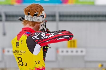 SEEFELD, AUSTRIA - JANUARY 19 Aidan Millar of team Canada places 9th in the mixed biathlon relay event on January 19, 2012 in Seefeld, Austria.