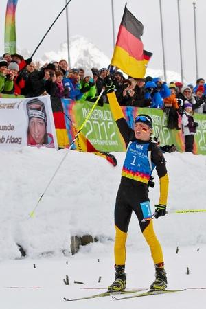 innbruck: SEEFELD, AUSTRIA - JANUARY 19 Niklas Homberg of team Germany wins the mixed biathlon relay event on January 19, 2012 in Seefeld, Austria.