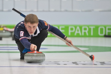 yog: INNSBRUCK, AUSTRIA - JANUARY 20 Mikhail Vaskov (Russia) and his partner from the Czech Republic beat team Estonia and Italy in the curling mixed doubles by 10:3 on January 20, 2012 in Innsbruck, Austria.