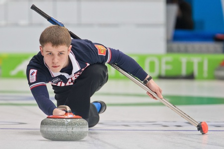 INNSBRUCK, AUSTRIA - JANUARY 20 Mikhail Vaskov (Russia) and his partner from the Czech Republic beat team Estonia and Italy in the curling mixed doubles by 10:3 on January 20, 2012 in Innsbruck, Austria.