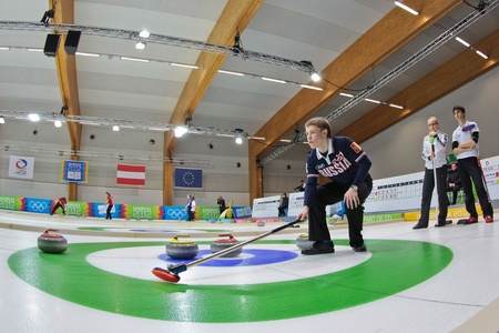 innbruck: INNSBRUCK, AUSTRIA - JANUARY 20 Mikhail Vaskov (Russia) and his partner from the Czech Republic beat team Estonia and Italy in the curling mixed doubles by 10:3 on January 20, 2012 in Innsbruck, Austria.