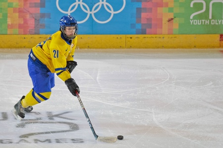 INNSBRUCK, AUSTRIA - JANUARY 20 Emmy Alasalmi (Sweden) and her team beat Kazachstan 11:0 in the ladies ice hockey tournament on January 20, 2012 in Innsbruck, Austria. Editorial