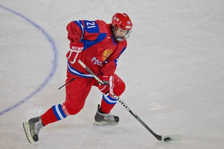 INNSBRUCK, AUSTRIA - JANUARY 20 Andrey Svetlakov (Russia) and his team beat the USA 5:2 in the semi finals of the ice hockey tournament on January 20, 2012 in Innsbruck, Austria. Stock Photo - 12160266