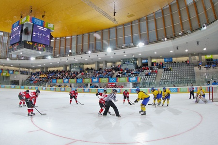INNSBRUCK, AUSTRIA - JANUARY 22 Sweden beats Austria 3:0 in the ladies' ice hockey tournament and wins the gold medal on January 22, 2012 in Innsbruck, Austria. Stock Photo - 12160284