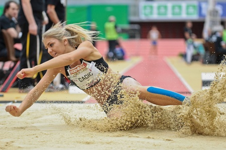 LINZ, AUSTRIA - FEBRUARY 2 Ivona Dadic (Austria) places 4th in the women's long jump event on February 2, 2012 in Linz, Austria. Stock Photo - 13160838