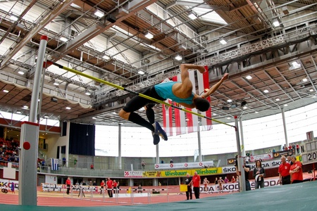 linz: LINZ, AUSTRIA - FEBRUARY 25: Josip Kopic (#28, Austria) places second in the mens high jump event in Linz, Austria on February 25, 2012.