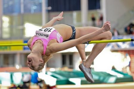 linz: LINZ, AUSTRIA - FEBRUARY 25: Ekaterina Kuntsevich (#197, Austria) places second in the womens high jump event in Linz, Austria on February 25, 2012.