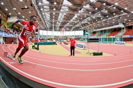 linz: LINZ, AUSTRIA - FEBRUARY 25: Ekemini Bassey (#121, Austria) and his team win the mens 4x200m relay event in Linz, Austria on February 25, 2012.