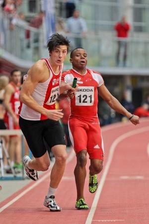 LINZ, AUSTRIA - FEBRUARY 25: Ekemini Bassey (#121, Austria) and his team win the men's 4x200m relay event in Linz, Austria on February 25, 2012. Stock Photo - 13160830