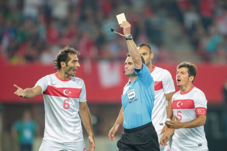VIENNA,  AUSTRIA - AUGUST 15 Hamit Altintop (#6 Turkey)  argues with referee Jan Valasek during the friendly soccer game on August 15, 2012 in Vienna, Austria.