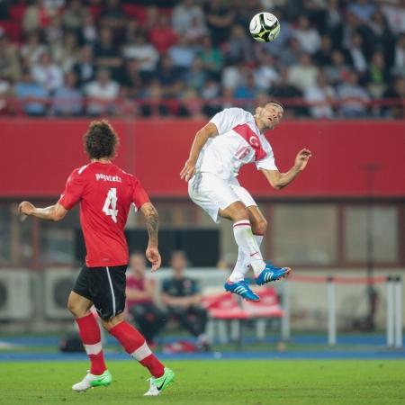 VIENNA,  AUSTRIA - AUGUST 15 Emanuel Pogatetz (#4 Austria) and Mevluet Erdinc (#16 Turkey) fight for the ball during the friendly soccer game on August 15, 2012 in Vienna, Austria.