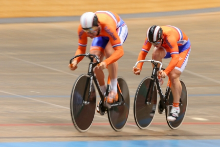 VIENNA,  AUSTRIA - SEPTEMBER 27  Hugo Haag and Jeffrey Hoogland (Netherlands) compete in the men's team sprint event of an indoor cycling meeting on September 27, 2012 in Vienna, Austria. Stock Photo - 16745592