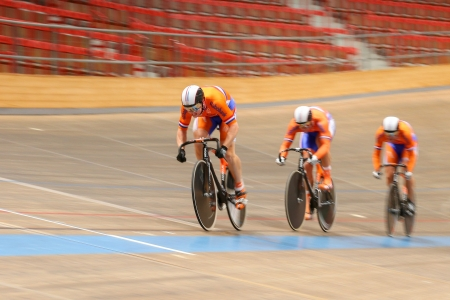 keirin: VIENNA,  AUSTRIA - SEPTEMBER 27  Hugo Haag,  Nils van Hoenderdaal, and Jeffrey Hoogland (Netherlands) compete in the mens team sprint event of an indoor cycling meeting on September 27, 2012 in Vienna, Austria.