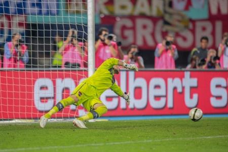 qualifier: VIENNA,  AUSTRIA - SEPTEMBER 11 Robert Almer (#1 Austria) tries to catch the ball during the WC qualifier soccer game on September 11, 2012 in Vienna, Austria.