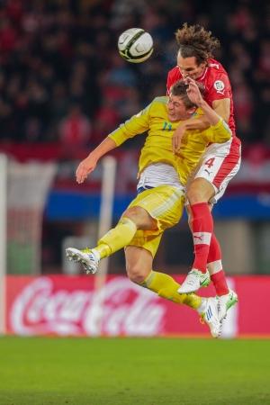qualifier: VIENNA,  AUSTRIA - OCTOBER 16 Emanuel Pogatetz (#4 Austria) and Sergei Gridin (#11 Kazakhstan) fight for the ball during the WC qualifier soccer game on October 16, 2012 in Vienna, Austria.