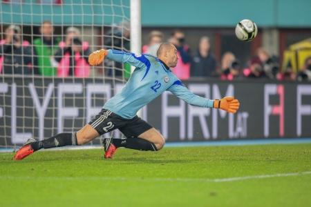 qualifier: VIENNA,  AUSTRIA - OCTOBER 16 Andrei Sidelnikov (#22 Kazakhstan) deflects the ball during the WC qualifier soccer game on October 16, 2012 in Vienna, Austria.