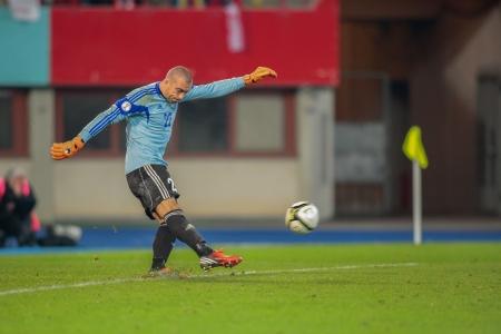 qualifier: VIENNA,  AUSTRIA - OCTOBER 16 Andrei Sidelnikov (#22 Kazakhstan) kicks the ball during the WC qualifier soccer game on October 16, 2012 in Vienna, Austria.