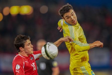 qualifier: VIENNA,  AUSTRIA - OCTOBER 16 Zlatko Junuzovic (#10 Austria) and Kairat Nurdauletov (#6 Kazakhstan) fight for the ball during the WC qualifier soccer game on October 16, 2012 in Vienna, Austria.