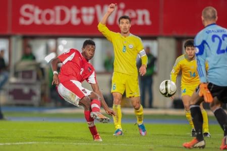 qualifier: VIENNA,  AUSTRIA - OCTOBER 16 David Alaba (#8 Austria) scores a goal during the WC qualifier soccer game on October 16, 2012 in Vienna, Austria.