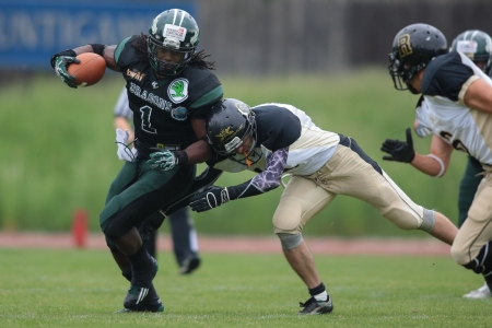 VIENNA, AUSTRIA - MAY 12 RB Tunde Ogun (#1 Dragons) is tackled on May 12, 2012 in Vienna, Austria.