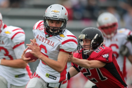 VIENNA, AUSTRIA - JUNE 9 QB Adrian Platzgummer (#6 Austria) runs with the ball on June 9, 2012 in Vienna, Austria.