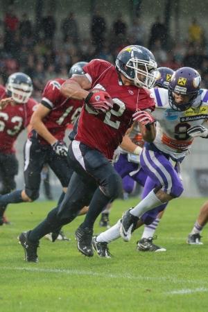 VADUZ, LIECHTENSTEIN - JULY 21 DB DJ Wolfe (#32 Broncos) runs with the ball on July 21, 2012 in Vaduz, Liechtenstein.