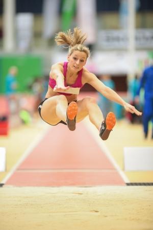 linz: LINZ, AUSTRIA - JANUARY 31 Michaela Egger (#507 Austria) competes in the womens long jump event on January 31, 2013 in Linz, Austria.