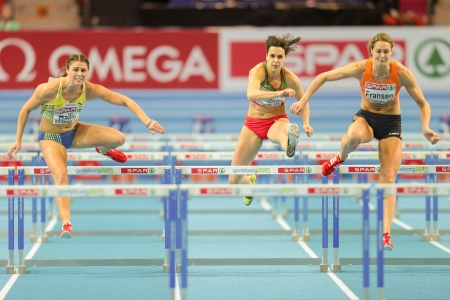 pentathlon: GOTHENBURG, SWEDEN - MARCH 1  Remona Fransen (Netherlands) wins heat 1 of the qualification of the pentathlon womens 60m hurdles event during the European Athletics Indoor Championship on March 1, 2013 in Gothenburg, Sweden.