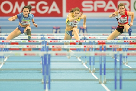 pentathlon: GOTHENBURG, SWEDEN - MARCH 1 Sofia Linde (Sweden) places 5th in heat 2 of the qualification of the pentathlon womens 60m hurdles event during the European Athletics Indoor Championship on March 1, 2013 in Gothenburg, Sweden. Editorial